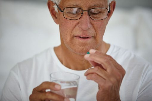 old man with pill